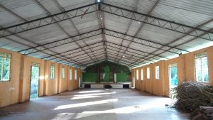 The hall belonging to the school which if refurbished could become a key facility for the boys and locally and help to make the home more self-sufficient .